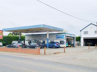 Buy a Freehold Mot Garage, Shop And 2-Bedroom Flat